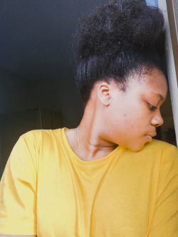 Black girl, just before wash day, relaxed hair