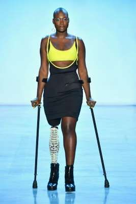a person standing in front of water: Amputee model Mama Cax makes her debut at NYFW