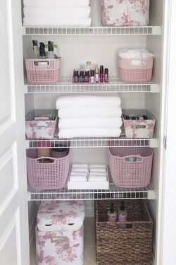 How cute is this pink floral themed linen closet?! I love that toilet paper storage bin!