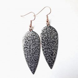 Black and silver textured oval dagger earrings.