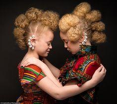Couple photographs black girls' natural hair in photos