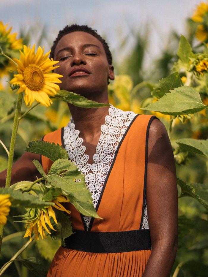 Sunflower. Orange dress. Dark skinned. Beauty shoot. TWA. 4c hair. Short hair. Natural hair.