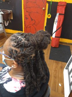 Barrels up into a braided bun, large ropes