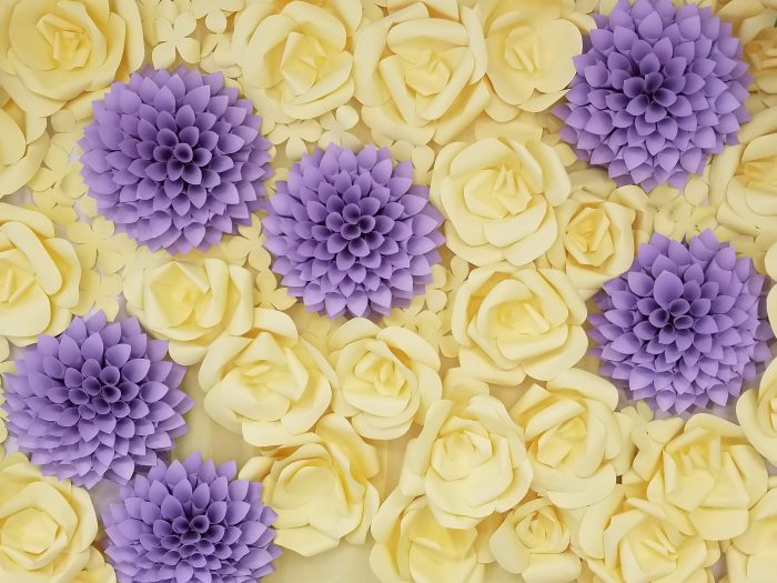 Flower Wall Baby shower to the nursey room. Lilac and yellow paper flowers.