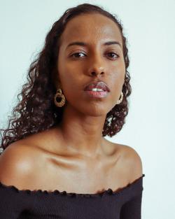 Hi, I'm Meklit, a Black woman photographer and I shoot Black women. Stick around for more  ...