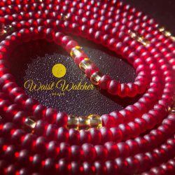 Red and gold waist beads.