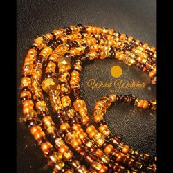 Honey colored waist beads.