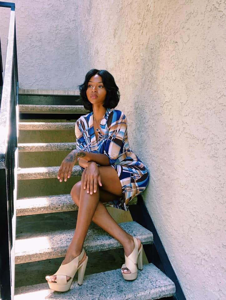 Black Woman Posing in A Stairwell • 70s Look