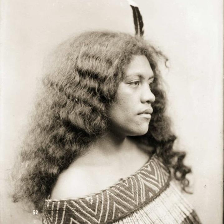 Head and shoulders portrait of Tini Ratana of Parikino, Wanganui River. She is wearing a piupiu  ...