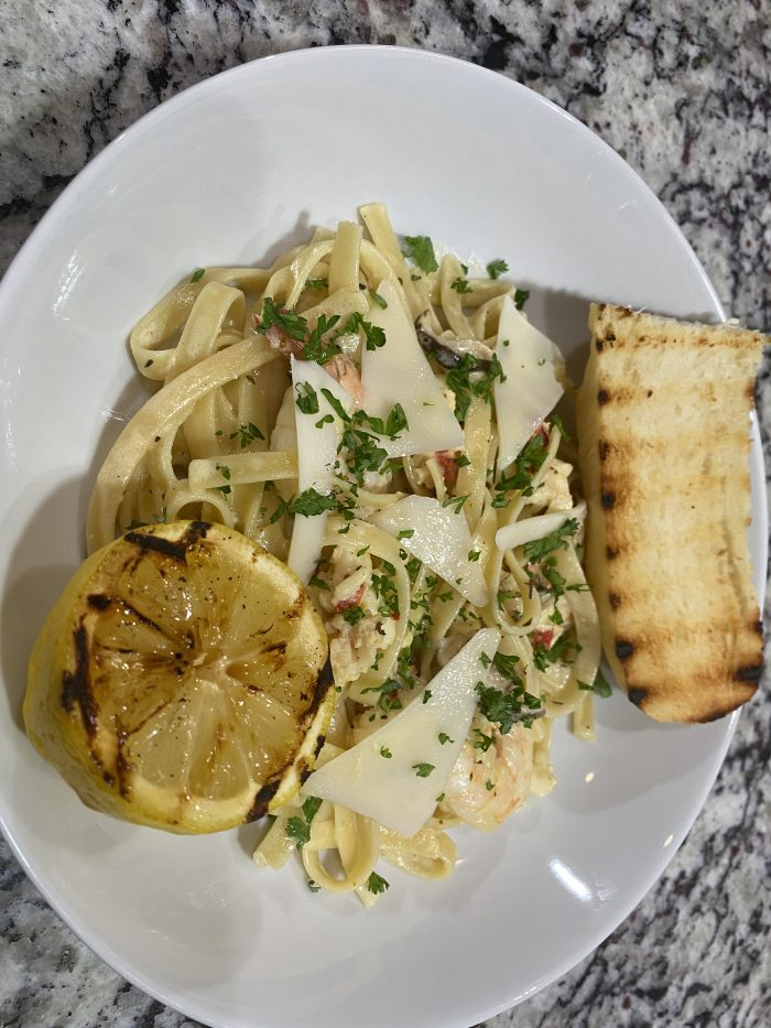 Shrimp and lobster Alfredo with white wine sauce.